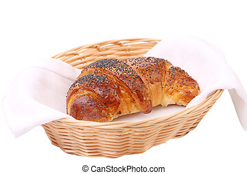 Image of croissant with poppy in a basket.