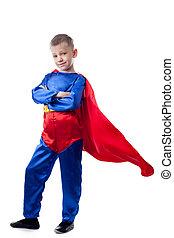 Image of cute boy posing in Superman costume