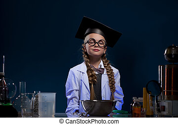 Image of cute little girl posing in graduate hat