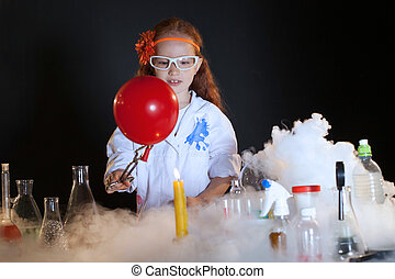 Image of cute little schoolgirl watching reagents - Image of...