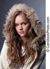 Image of enchanting young girl posing in fur hood, close-up