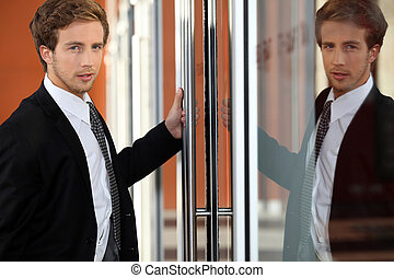 Image of executive reflected in glass