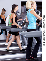 ladies jogging on trademill - image of fit ladies jogging on...