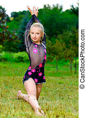 flexible little girl doing gymnastics split
