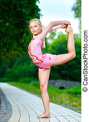 flexible little girl doing gymnastics vertical split