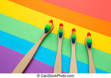 Image of four toothbrushes located in center. - Image of...