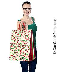 Image of glamorous shopping girl holding bags