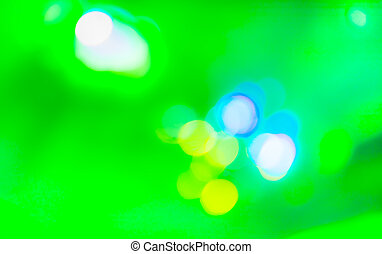image of green , blue and yellow background with bokeh.