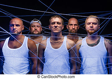 Image of group of men tangled in threads in ultraviolet