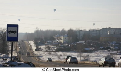 Image of hot air balloons flying over city