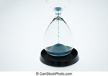 Image of hourglass with blue sand on isolated white background