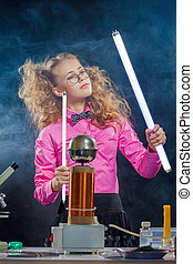 Image of ingenious girl conducting experiment, close-up