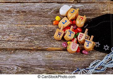 Image of jewish holiday Hanukkah with wooden dreidel