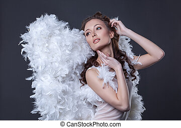 Image of lovely woman in angel costume with wings