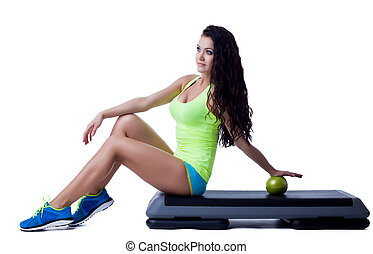Image of lovely young brunette sitting on stepper