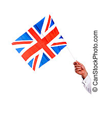 Image of males hand holding UK flag. Copy space