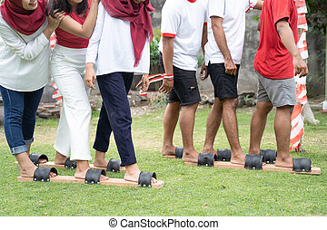 image of many legs participating in the bakiak race