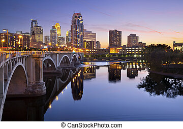Image of Minneapolis downtown skyline at sunset.