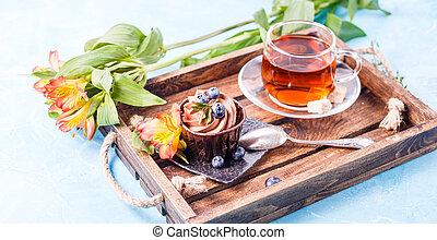 Image of morning cake, blueberries, black tea