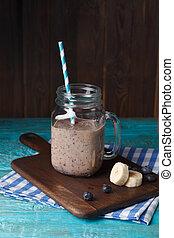Image of mug with milkshake with straw