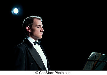 Image of music conductor focused before the show