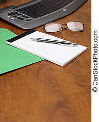 image of notepad and pen on wooden desk
