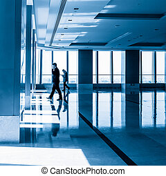 image of People silhouettes at morden office building -...