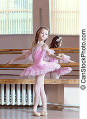 Image of petite ballerina posing in pink tutu
