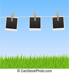 Image of pictures hanging on a clothes line with a sky and grass background.