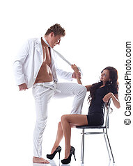 Image of playful young couple flirting in studio