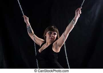 Image of pudgy woman holding chains