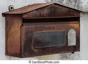 image of rusted mailboxes on stone wall.
