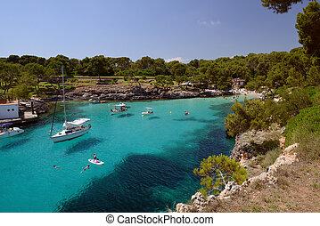 sailing yacht in a beautiful blue lagoon