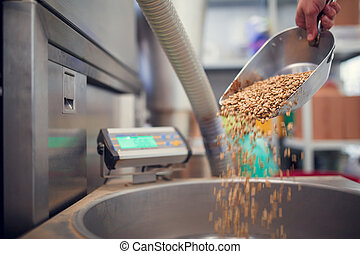 Image of scoop with coffee beans, industrial scales