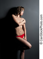 Image of seductive woman posing in red lingerie