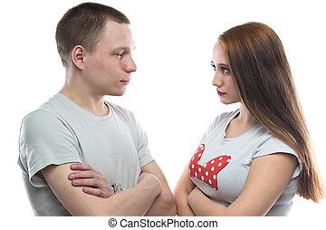 Image of serious teenage boy and girl