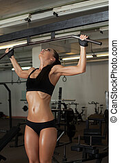Image of sexy sweaty girl exercising in gym