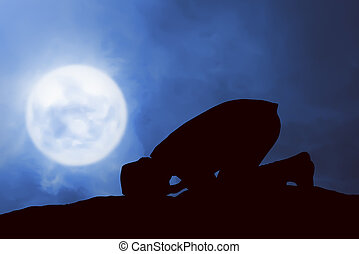 Image of silhouette man praying