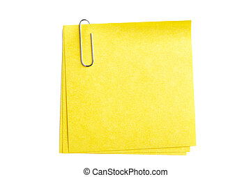 silver paper clip with yellow paper