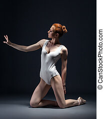 Image of skinny young ballerina posing in studio