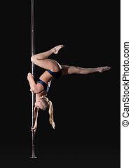 Image of slim graceful pole dancer, isolated on black