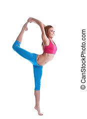 Image of smiling skinny woman doing vertical split