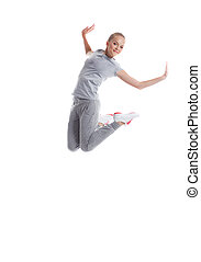 Image of smiling sporty girl jumping in studio