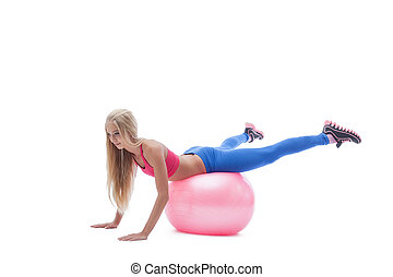 Image of sporty blonde exercising on fitness ball