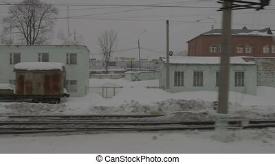 Image of station from moving train