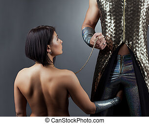 Image of strict man holding his partner on leash