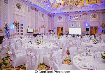 image of tables setting at wedding hall