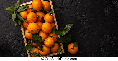 Image of tangerines in wooden box