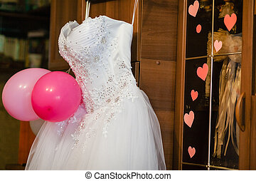 image of the bodice of a weeding dress on a hanger