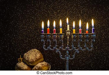 Image of the Hanukkah Jewish holiday with a menorah and...